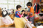Education Preschool 4-5 year olds pretend play boy and girl talking care of stuffed animal using stethoscope girl is wearing dressup outfit