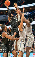WASHINGTON, DC - FEBRUARY 19: Nate Watson #0 of Providence shoots over Timothy Ighoefe #5 of Georgetown during a game between Providence and Georgetown at Capital One Arena on February 19, 2020 in Washington, DC.