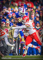 9 November 2014: Buffalo Bills running back Anthony Dixon breaks tackles for a 27 yard gain against the Kansas City Chiefs in the third quarter at Ralph Wilson Stadium in Orchard Park, NY. The Chiefs rallied with two fourth quarter touchdowns to defeat the Bills 17-13. Mandatory Credit: Ed Wolfstein Photo. The original image was made as a RAW (NEF) file using a Nikon D4 DSLR camera.