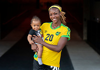 HOUSTON, TX - JUNE 10: Cheyna Matthews #20 of Jamaica poses with her son after a game between Nigeria and Jamaica at BBVA Stadium on June 10, 2021 in Houston, Texas.