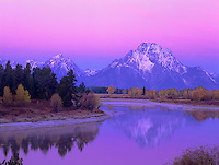 749450317 predawn alpenglow on mount moran and the teton range with the oxbow bend of the snake river and fall colored aspens in the foreground in grand tetons national park wyoming