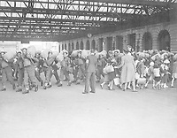 A scene at a London railway station showing troops arriving while kiddies who are being evacuated from London leave for the reception area.  Ca. 1940.   New Times Paris Bureau Collection.  (USIA)<br /> Exact Date Shot Unknown<br /> NARA FILE #:  306-NT-3170V<br /> WAR & CONFLICT BOOK #:  1013