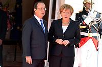 PARIS, FRANCE - 2014: FILE PHOTOS -   Francois Hollande, Angela Merkel <br /> <br /> People:  Francois Hollande, Angela Merkel