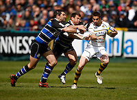 Photo: Richard Lane/Richard Lane Photography. Bath Rugby v London Wasps. Aviva Premiership. 21/04/2012. Wasps' Nick Robinson is tackled by Bath's Stephen Donald and Lee Mears.