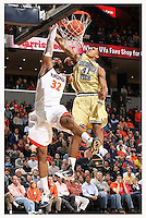 Virginia's Mike Scott(32) slams the ball in front of Georgia Tech's Glen Rice, Jr. during an ACC college basketball game Wednesday Jan. 13, 2010 in Charlottesville, Va. Virginia won 82-75.  ( Photo/Andrew Shurtleff)