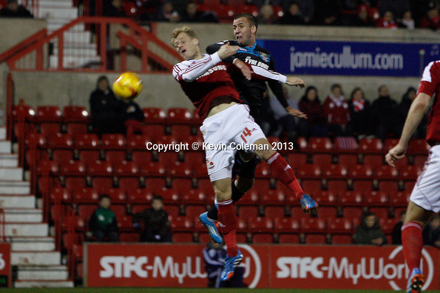 Jimmy Smith of Stevenage and Jay McEveley of Swindon challenge for a header<br />  - Swindon Town v Stevenage - Johnstone's Paint Trophy - Southern Section Semi-final  - County Ground, Swindon - 10th December, 2013<br />  © Kevin Coleman 2013