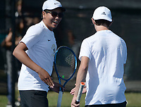 Bentonville's Santiago Aguirre (left) and doubles partner Boyce Read celebrate a point Tuesday, Oct. 12, 2021, during the 6A state tennis finals at Memorial Park in Bentonville. Visit nwaonline.com/211013Daily/ for today's photo gallery.<br /> (NWA Democrat-Gazette/Andy Shupe)
