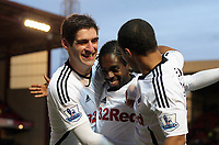Pictured: Nathan Dyer of Swansea (C) celebrating his goal with team mates Danny Graham and Wayne Routledge. Saturday 07 January 2012<br /> Re: FA Cup football Barnsley FC v Swansea City FC at the Oakwell Stadium, south Yorkshire.