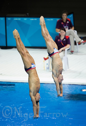 26 JUL 2012 - LONDON, GBR - Tom Daley (GBR) (left) and Peter Waterfield (GBR) (right) of Great Britain practice at the Aquatics Centre in the Olympic Park, Stratford, London, Great Britain ahead of the London 2012 Olympic Games 10m Synchronised Diving .(PHOTO (C) 2012 NIGEL FARROW)
