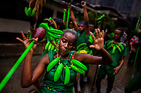Afro-Colombian dancers of the Pandeyuca neighborhood perform in the rain during the San Pacho festival in Quibdó, Colombia, 29 September 2019. Every year at the turn of September and October, the capital of the Pacific region of Chocó holds the celebrations in honor of Saint Francis of Assisi (locally named as San Pacho), recognized as Intangible Cultural Heritage by UNESCO. Each day carnival groups, wearing bright colorful costumes and representing each neighborhood, dance throughout the city, supported by brass bands playing live music. The festival culminates in a traditional boat ride on the Atrato River, followed by massive religious processions, which accent the pillars of Afro-Colombian's identity – the Catholic devotion grown from African roots.