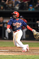 Memphis Redbirds third baseman Jermaine Curtis (23) at bat during a game against the Oklahoma City RedHawks on May 23, 2014 at AutoZone Park in Memphis, Tennessee.  Oklahoma City defeated Memphis 12-10.  (Mike Janes/Four Seam Images)