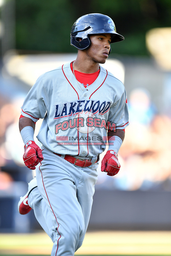Lakewood BlueClaws Luis Garcia (3) runs to first base during a game against the Asheville Tourists at McCormick Field on June 14, 2019 in Asheville, North Carolina. The BlueClaws defeated the Tourists 7-5. (Tony Farlow/Four Seam Images)