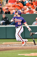 Clemson Tigers catcher Chris Okey (25) swings at a pitch during a game against the Maine Black Bears at Doug Kingsmore Stadium on February 20, 2016 in Clemson, South Carolina. The Tigers defeated the Black Bears 9-4. (Tony Farlow/Four Seam Images)