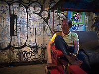 Tuk Tuk Drivers at night in Siem Reap, Cambodia