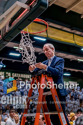 16 March 2019: University of Vermont President Tom Sullivan, cuts himself a piece of net after a UVM victory over the UMBC Retrievers in the America East Championship Game at Patrick Gymnasium in Burlington, Vermont. The Catamounts defeated the Retrievers 66-49, avenging their loss against the same team in last years' Championship Game. Mandatory Credit: Ed Wolfstein Photo *** RAW (NEF) Image File Available ***