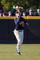 Center fielder Jarrett Parker #3 of the Virginia Cavaliers catches a fly ball at Clark-LeClair Stadium on February 19, 2010 in Greenville, North Carolina.   Photo by Brian Westerholt / Four Seam Images