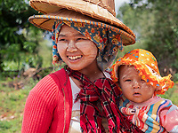 Rural portraits in the Shan State Myanmar Women waiting for her husband with her baby along a rural road