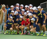Switserland, Genève, September 20, 2015, Tennis,   Davis Cup, Switserland-Netherlands, Roger Federer (SUI) posing with ballkids after his match<br /> Photo: Tennisimages/Henk Koster