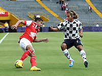 BOGOTA - COLOMBIA -22 -03-2014: Juan Roa (Izq.) jugador de Independiente Santa Fe disputa el balón con Diego Chica (Der.) jugador de Boyaca Chico FC, durante partido por la fecha 12 de la Liga Postobon I-2014, jugado en el estadio Nemesio Camacho El Campin de la ciudad de Bogota. / Juan Roa (L) player of Independiente Santa Fe vies for the ball with Diego Chica (R) player of Boyaca Chico FC during a match for the 12th date of the Liga Postobon I-2014 at the Nemesio Camacho El Campin Stadium in Bogota city, Photo: VizzorImage  / Luis Ramirez / Staff.