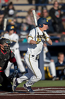 Michigan Wolverines first baseman Jimmy Kerr (15) follows through on his swing against the Rutgers Scarlet Knights on April 26, 2019 in the NCAA baseball game at Ray Fisher Stadium in Ann Arbor, Michigan. Michigan defeated Rutgers 8-3. (Andrew Woolley/Four Seam Images)