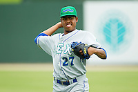 Lexington Legends starting pitcher Miguel Almonte (27) warms up in the outfield prior to the game against the Kannapolis Intimidators at CMC-Northeast Stadium on July 31, 2013 in Kannapolis, North Carolina.  The Intimidators defeated the Legends 3-2.  (Brian Westerholt/Four Seam Images)