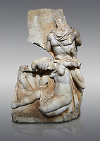 Roman Sebasteion relief sculpture of Nero conquering Armenia Aphrodisias Museum, Aphrodisias, Turkey. <br /> <br /> Nero, wearing only a cloak and sword strap, supports a slumped naked Armenia by her upper arms. She wears a soft eastern hat, and her bow and quiver are next to her. The heroic composition likens them to Achilles and the Amazon Queen Penthesilea. The inscription reads: Armenia - (Neron) Klaudios Drousos Kaisar Sebastos Germanikos.