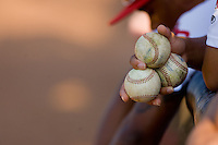 A Johnson City Cardinals player holds three baseballs in his hand at Howard Johnson Field July 3, 2010, in Johnson City, Tennessee.  Photo by Brian Westerholt / Four Seam Images