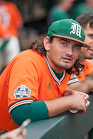 Miami Hurricanes pinch hitter Peter Crocitto (44) in the dugout before Game 5 of the NCAA College World Series against the UC Santa Barbara Gauchos on June 20, 2016 at TD Ameritrade Park in Omaha, Nebraska. UC Santa Barbara defeated Miami  5-3. (Andrew Woolley/Four Seam Images)