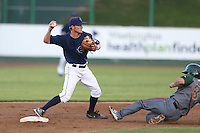 Nelson Ward #2 of the Everett AquaSox throws to first base while avoiding a sliding Justin Marra #8 of the Boise Hawks during a game at Everett Memorial Stadium on July 25, 2014 in Everett, Washington. Everett defeated Boise, 2-1. (Larry Goren/Four Seam Images)