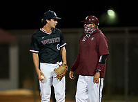Riverview Rams head coach Jeremy Schmidt talks with pitcher Karson Ligon (6) during a game against the Sarasota Sailors on February 19, 2021 at Rams Baseball Complex in Sarasota, Florida. (Mike Janes/Four Seam Images)