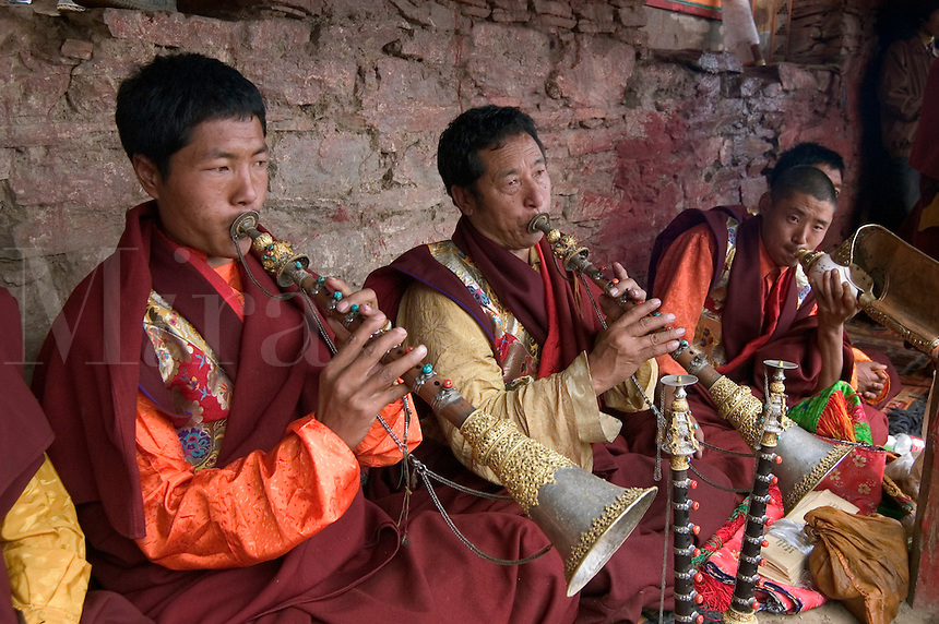 Buddhist monks play kanglings at the Cham dances, Katok Dorjeden Monastery - Kham, (eastern, Tibet), Sichuan Province, China