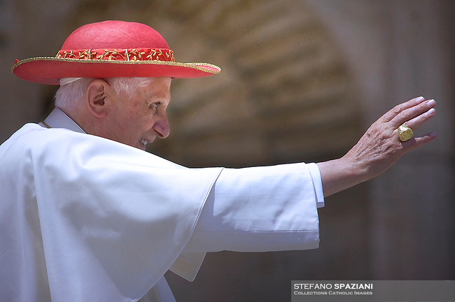 Pope Benedict XVI wears a 'saturno hat', inspired by the ringed planet Saturn, to shield himself from the sun as he waves pilgrims during his weekly general audience in St. Peter's Square at the Vatican, Wednesday, May. 23, 2007...