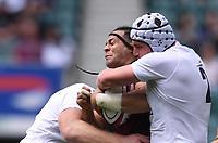 4th July 2021; Twickenham, London, England; International Rugby, Autumn Internationals, England versus United States of America; Josh McNally and Curtis Langdon of England tackle Mika Kruse of USA