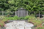 Walkway entering Oregon Gardens.  Oregon Gardens, Silverton, Oregon, USA, an 80 acre botanical garden in the Willamette Valley.