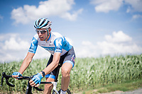 Nils Politt (DEU/Israel - StartUp Nation) cornering in at the Carrefour de l'Arbre cobbled section<br /> <br /> reconnaissance of the (delayed, due to the Covid19 pandemic) Paris-Roubaix course by Team Israel - StartUp Nation <br /> <br /> Nord-Pas de Calais region (FRA), 17 july 2020<br /> ©kramon