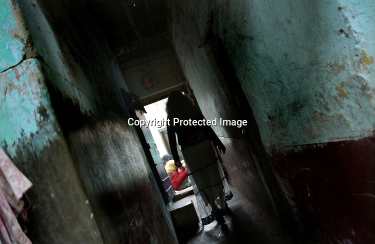 INDIA (West Bengal - Calcutta) -A sex worker passes through a narrow lane in a red light area in Kolkata, India- Arindam Mukherjee
