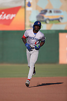 Lawrence Butler (4) of the Stockton Ports runs the bases after hitting a home run against the Inland Empire 66ers at San Manuel Stadium on June 27 2021 in San Bernardino, California. (Larry Goren/Four Seam Images)