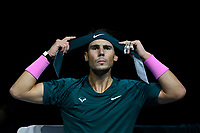 19th November 2020; O2, London;  Rafael Nadal of Spain adjusts his headband during the singles group match against StefanTsitsipas of Greece at the ATP, Tennis World Tour Finals 2020 in London