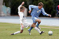 UNC's Michael Harrington (right) beats SMU's Scott Corbin (left) in midfield. Southern Methodist University defeated the University of North Carolina 3-2 in double overtime at Fetzer Field in Chapel Hill, North Carolina, Saturday, December 3, 2005.