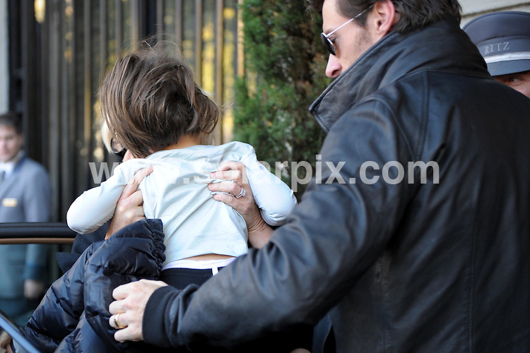 **ALL ROUND PICTURES FROM SOLARPIX.COM**.**WORDLWIDE SYNDICATION RIGHTS EXCEPT FOR SPAIN**NO PUBLICATION IN SPAIN**.The Australian actor Hugh Jackman with his wife Deborra Lee Furness and their daughter Eva Eliot in Madrid outside the hotel yesterday where Hugh had time to Signe autographs for his fans before his film premiere of the film Australia..This pic: Hugh Jackman with his wife Deborra Lee Furness and their daughter Eva Eliot.JOB REF:8070- PTG        DATE:02-12-08.**MUST CREDIT SOLARPIX.COM OR DOUBLE FEE WILL BE CHARGED* *UNDER NO CIRCUMSTANCES IS THIS IMAGE TO BE REPRODUCED FOR ANY ONLINE EDITION WITHOUT PRIOR PERMISSION*