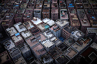 """Densely packed apartment buildings are seen from above in Shenzhen, China on Feb. 6 2012. The apartments are often called """"handshake buildings"""" because they are so close that neighbors can reach across."""