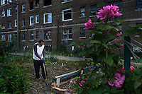 Xavier working in the Birdtown Community Garden. Community gardens are sprouting up all over Detroit, Michigan in an attempt to soften the blight and decay in urban areas of the city.