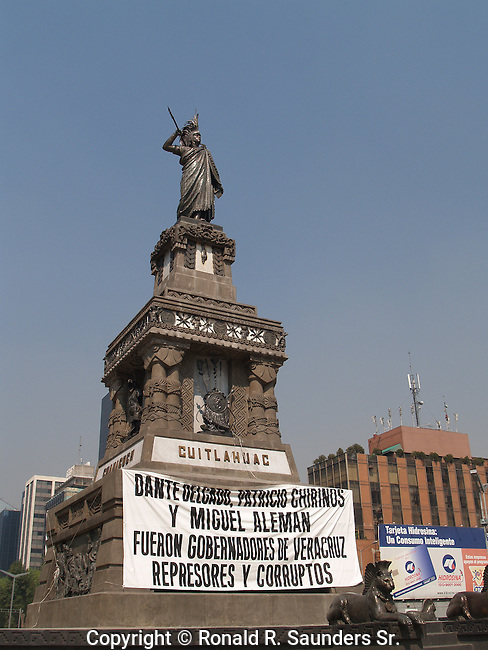 BANNER at the BASE of the CUITAHUAC STATUE PROVIDES a PLATFORM to PROTEST POLITICAL CORRUPTION
