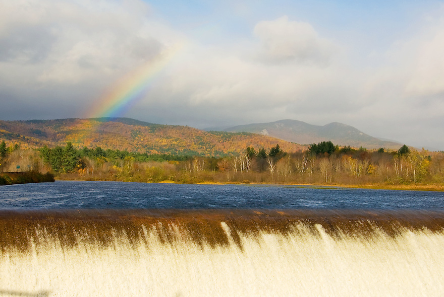 A fleeting rainbow adds to the autumn grandeur in this view of Welch and Dickey over Campton Pond.