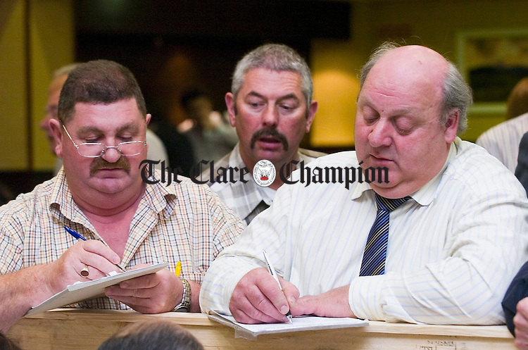 Gerry Murtagh and Seamus Molloy keep an eye on the ballot papers at the Clare General Election Count in the West County Hotel, Ennis. Photograph by John Kelly.