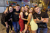 Pictured: A group of young people pose for the camera in Wind Street, Swansea. Monday 31 December 2018 and Tuesday 01 January 2019<br /> Re: New Year revellers in Wind Street, Swansea, Wales, UK