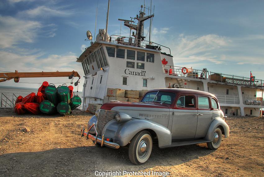 Vintage car and Coast Guard vessel at Norman Wells.