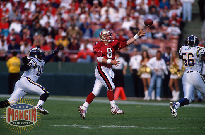 SAN FRANCISCO, CA:  Quarterback Steve Young of the San Francisco 49ers throws a pass during the NFC Divisional Playoff game against the Minnesota Vikings at Candlestick Park in San Francisco, California on January 3, 1998. (Photo by Brad Mangin)