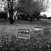 South eastern, Pennsylvania.USA.October 23, 2004..Bush and Kerry signs face off in front of the same house..