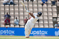 Rishabh Pant, India dances down the wicket and drives Neil Wagner, New Zealand through the off side for four runs during India vs New Zealand, ICC World Test Championship Final Cricket at The Hampshire Bowl on 23rd June 2021